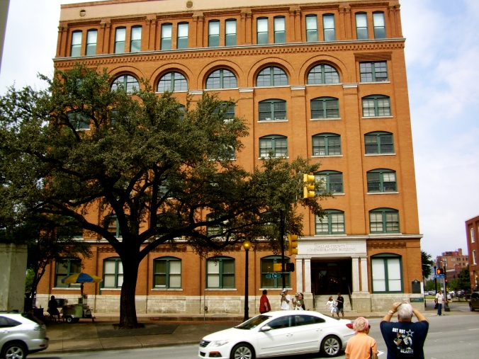 The Texas Book Depository - Oswald was at the window on the sixth floor (obviously the tree wasn't quite as tall).