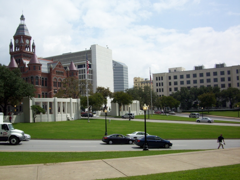 Across the street from the book depository and the grassy knoll.