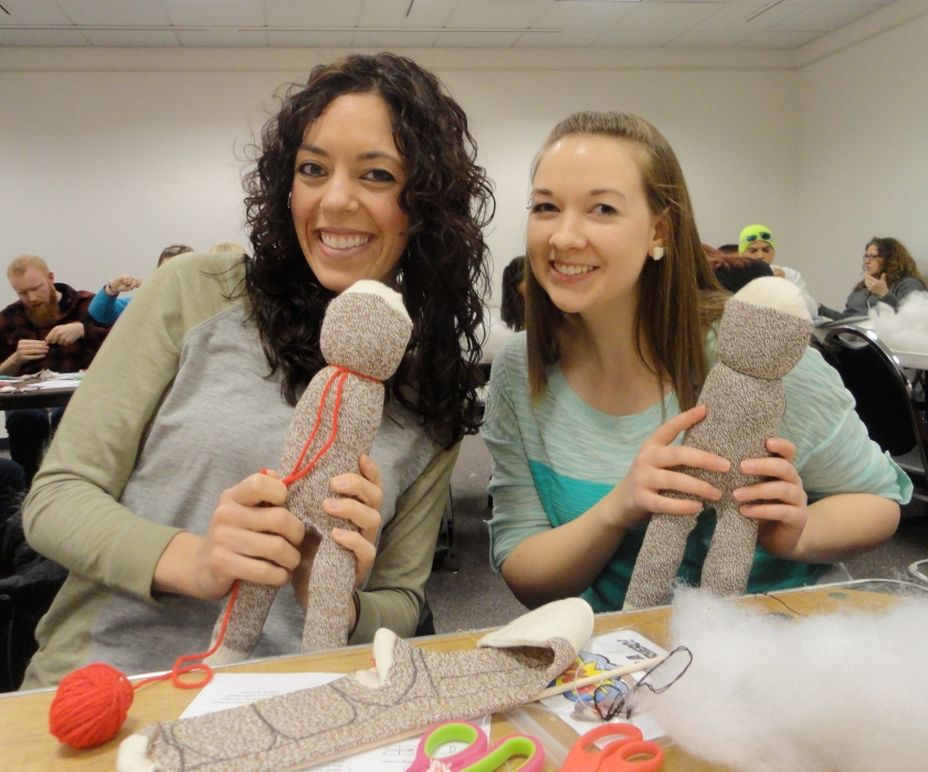 Andrea and Liz make their sock monkeys.