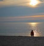 The sun still high in the sky and Elizabeth on the beach.